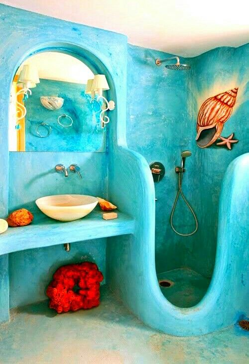 blue cob bathroom, marmer round sink, sconces, shell drawing on shower area