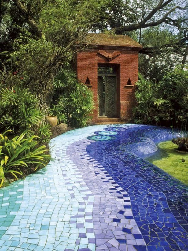 blue gradation tiny mosaic tiles on the pathway with plants and garden pool on the side