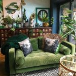 Bohemian Living Room With Wooden Floor, Green Sofa, Beige Ceiling, Light And Dark Blue Wall, Black White Rug, Rattan Coffee Table With Glass Top
