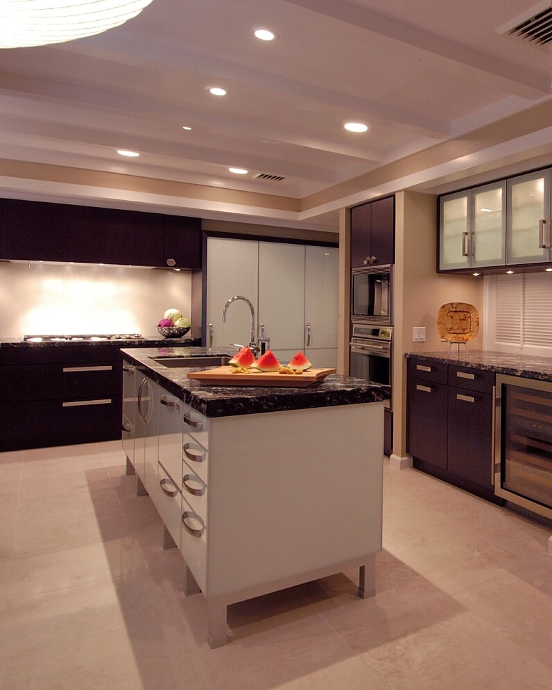 cabinets to ceiling backsplash black granite countertops grey island frosted glass cabinet doors built in appliances wine cellar sink stovetop
