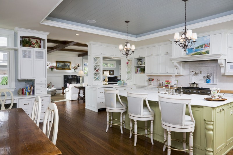 cabinets to ceiling classic pendant lamps white cabinets white countertop green island backsplash stovetop range hood white bar stools sink faucet