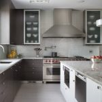 Cabinets To Ceiling Glass Cabinet Doors Mosaic Wall Tile White Countertop Island Range Hood Stovetop Sink Faucet Glass Pendant Lamps Built In Appliances Window