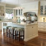 Cabinets To Ceiling Glass Windows Crystal Chandelier Wooden Floor Stools White Island White Cabinets Glass Cabinet Doors Sink Faucet Stovetop Shelves
