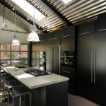 Cabinets To Ceiling Industrial Pendant Lamps Black Cabinet Black Island White Countertop Slopped Ceiling Skylight Black Built In Appliances Stovetop Black Stools Sink