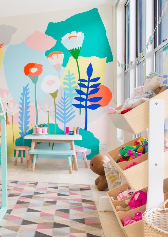 children's room, white floor, soft geometric rug, wooden boxes rack, wolorful wallpaper, children's table stool and bench