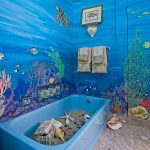 Coastal Bathroom, Blue Wall, Mural Wall, Blue Tub With Sands And Beach Accessories, Sandy Brown Floor, Shower