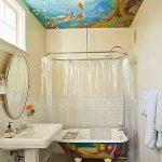 Coastal Bathroom, White Wall, White Tiles Backsplash, Beige Floor, Mermaid Drawing Tiles On The Floor, White Sink, Mirror, Octopus Drawing On The Tub, Sea Water Drawing On The Ceiling