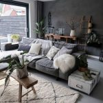 Dark Small Living Room, Grey Floor, Grey Sofa, White Rug, White Side Table, Dark Grey Wall, White Wall, Large Glass Sliding Door, Wooden Bench
