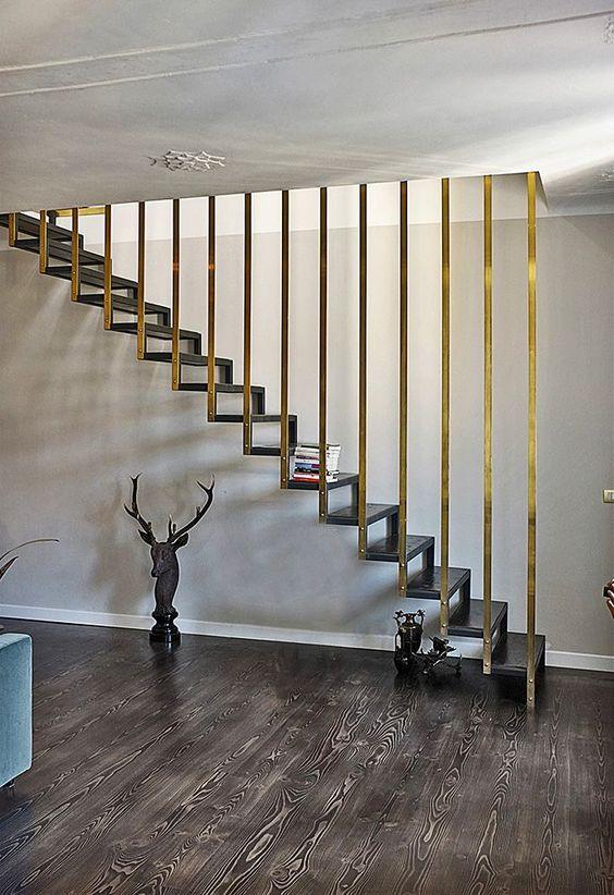 dark wooden stairs, golden metal railing, dark woodne floor, white wall