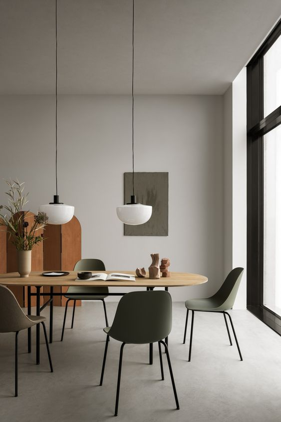 dining room, grey floor, sage green chair, wooden table, wooden divider, white long pendants, lighr grey wall