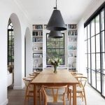 Dining Room, Wooden Floor, White Wall, Arch Entrances, Built In Shelves, Wooden Rectangular Table, Wooden Chairs Rattan Seating