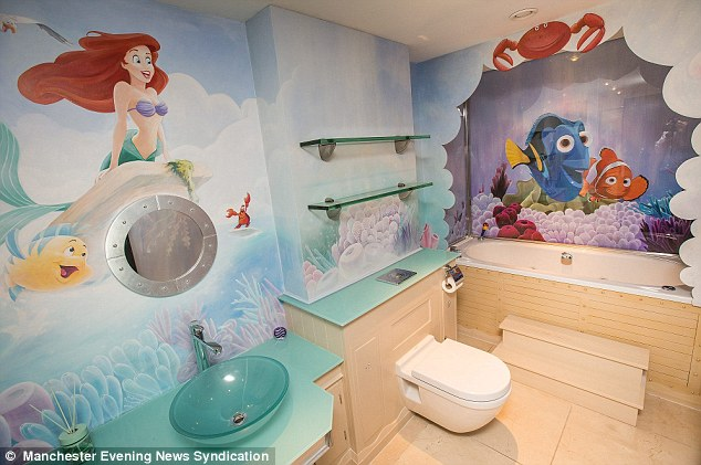 disney bathroom with ariel wallpaper, tosca shelves and vanity top, neo and dory wall on tub, beige tiles, wooden wall, white tub, white toilet