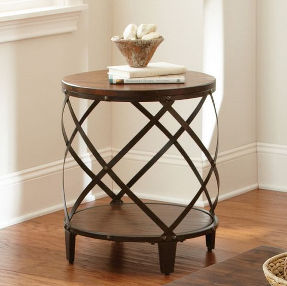 elegant wooden end table with round top, caged shelf