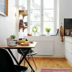 Foldable Wooden Dining Table, Black Midcentury Modern Chairs, White Wall, Wooden Floor, Glass Window, Floating Shelves, Rug