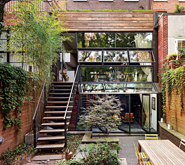 garden on the yard, on the ground, on the wall, oriental plants near the stairs