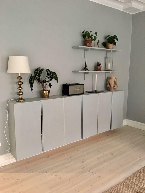 grey floating ivar cabinet in grey wall, wooden floor, grey floating shelves
