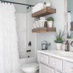 Guest Bathroom, Patterned Floor Tiles, White Tub, White Toilet, White Curtain, White Elegant Vanity, White Sink, Wooden Framed Mirrror, Floating Shelves