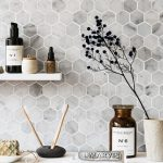 Hexagon Tiles On Backlash On The Bathroom With Floating Shelves