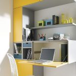 Home Office Corner With Grey Yellow Closed Cabinet, Opened Table, White Wire Chair