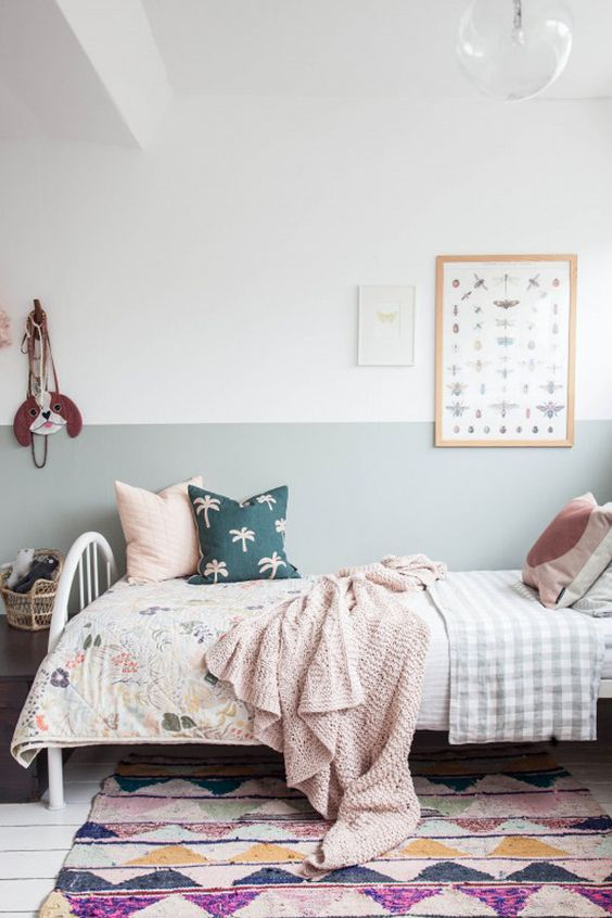 kids bedrom, white wooden floor, colorful rug, white iron bed, warm bedding, pillows, white gren wall