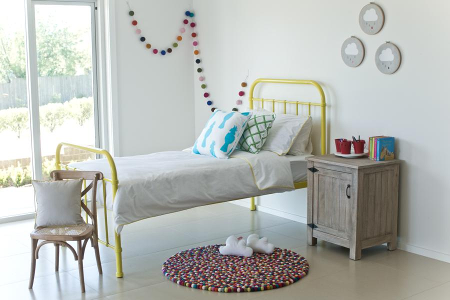 kids bedroom, white floor, white wall, wooden bedside table, wooden chair, yellow iron bed, white wall, window