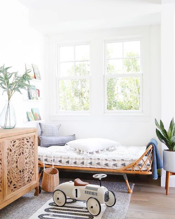 kids bedroom, wooden floor, white wall, rattan bed, rattan basket, toy, wooden cabinet with patters, floating shelves, plants