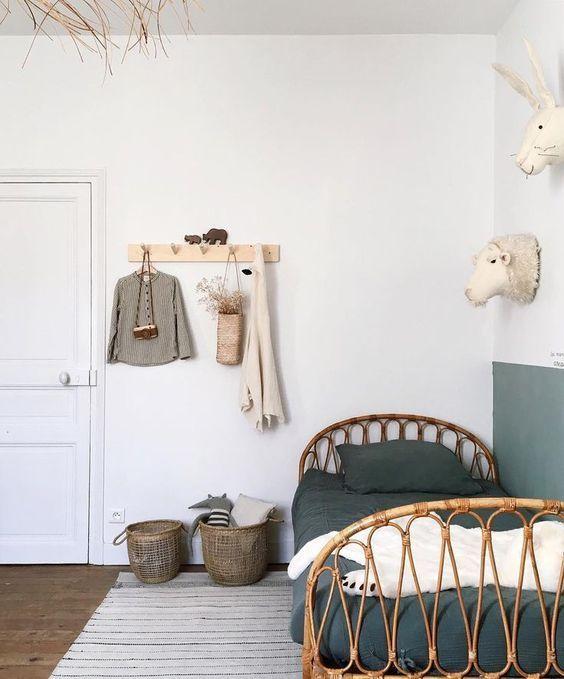 kids bedroom, wooden floor, white wall, wall decoration, wooden rail, rattan bed, rug, rattan basket