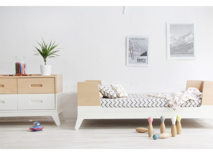 kids bedroom, wooden floor, wooden kids bed platform with wraparound boards, white brown cabinet