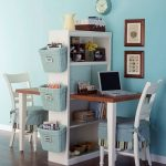 Kids Study Space Face To Face With Shelves In The Middle, Wooden Small Table, White Wooden Chairs With Blue Cover, Blue Basket On Side