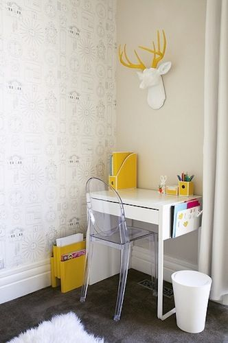 kids study space in the corner with white table, yellow decoration, clear acrylic chair