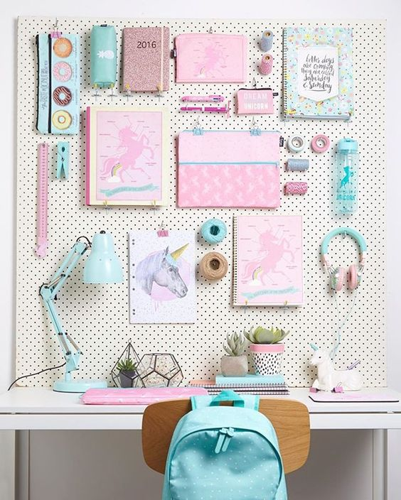 kids study space with white pegboard with school necessities, white table, wooden modern chair, table lamp