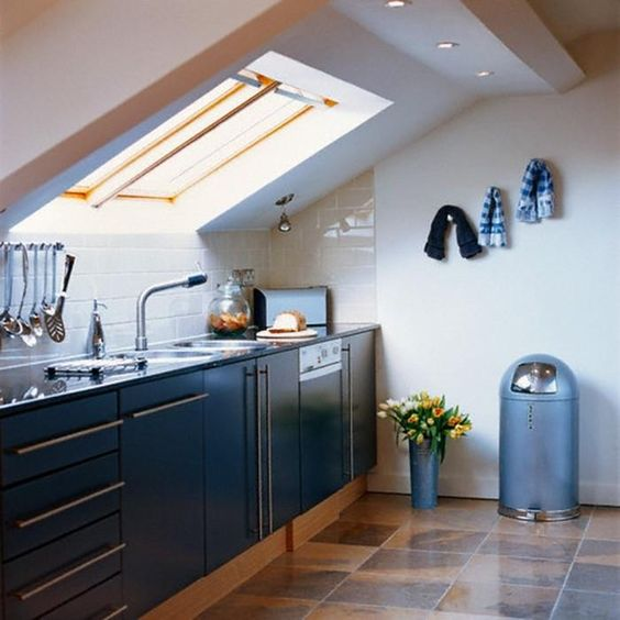 kitchen brown tiles, white wall, white backsplash wall, white sloping ceiling with windows, blue cabinet, blue top