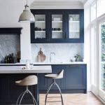Kitchen, Chevron Wooden Floor, Dark Blue Cabinet, White Top, White Wall, White Marble Backsplash, White Framed Glass Wall, Wooden Stool, White Pendant