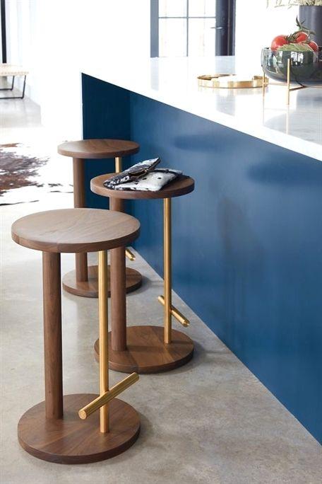 kitchen, grey floor, blue island, white top, wooden stool, golden lines for foot rest