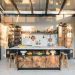 Kitchen, Grey Floor, Copper Island With Shelves Drawer, White Top, White Backsplash, Grey Wall, Black Shelves, Brown Cabinet, Wooden Stools