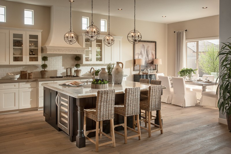 kitchen island dimensions with seating pendant lamps wine fridhe wooden floor white backsplash rangehood stovetop white cabinets sink windows