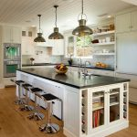 Kitchen Island Dimensions With Seating Wooden Island Industrial Pendant Lamps White Cabinets Windows Black Countertops Shelves Stovetop White Backsplash