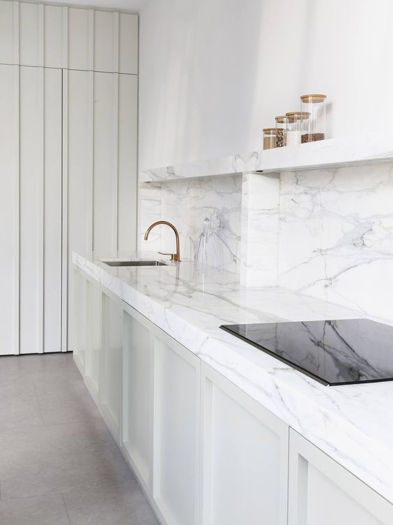 kitchen, light grey floor, white cabinet, white marble top, white marble open shelves, white wall
