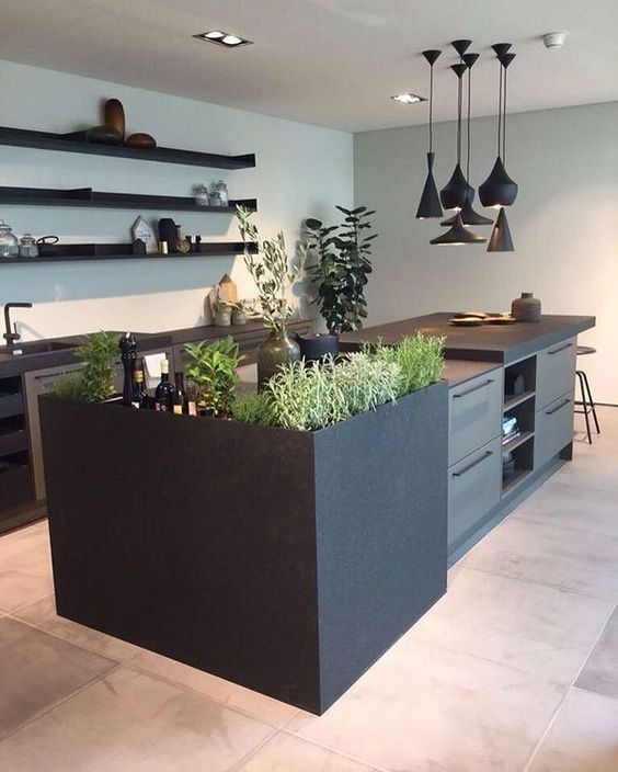 kitchen, marble floor tiles, off white wall, white ceiling, black cabinet, floating shelves, black island, plants on the island, black modern pendants