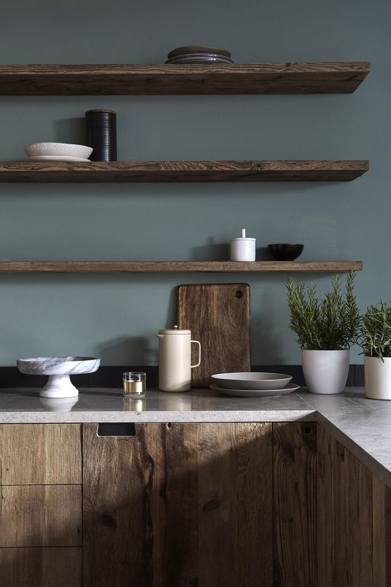 kitchen, muted green wall, wooden floating shelves, wooden cabinet with marble top
