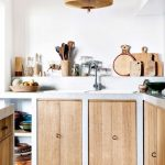 Kitchen, Patterned Floor Tiles, White Wall, White Counter Top, Wooden Door On Cabinet, Indented Wall For Shelves