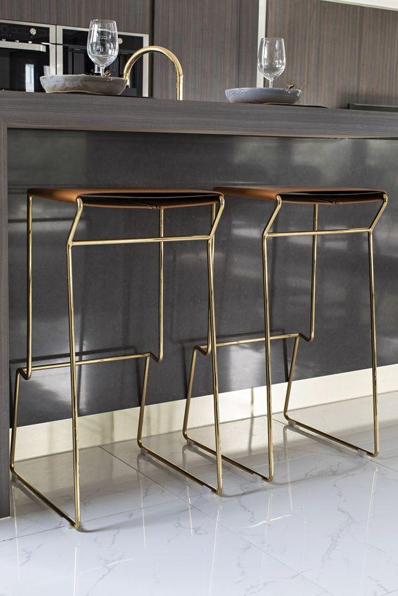 kitchen, white floor, brown thin seating, golden metal legs