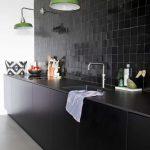 Kitchen With Black Backsplash Tiles, Black Bottom Cabinet, Black Counter Top, Green Sconces