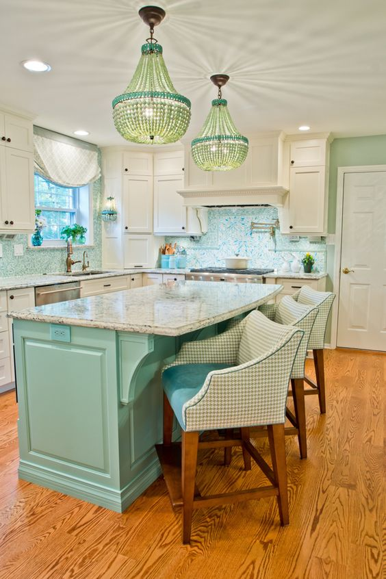 kitchen, wooden floor, blue island with marble top, wooden stool with white backs, blue seating, white cabinets, white countertop, blue backsplash, blue chandelier