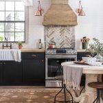 Kitchen, Wooden Floor, Brown Rug, White Round Dining Table, Brown Sool, White Subway Wall Tiles, Herringbone Tiles Backsplash, Brown Hood, Copper Sconces, Black Cabinet