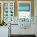 Kitchen, Wooden Floor, White Cabinet, Warm Brown Yelow Wall, White Framed Window, Blue White Backsplash Tiles, Bue Roman Shades, White Island, White Top, White Sink