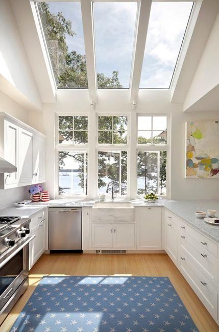kitchen, wooden floor, white cabinet, white ceiling, white wall, glass windows, glass ceiling, white marble