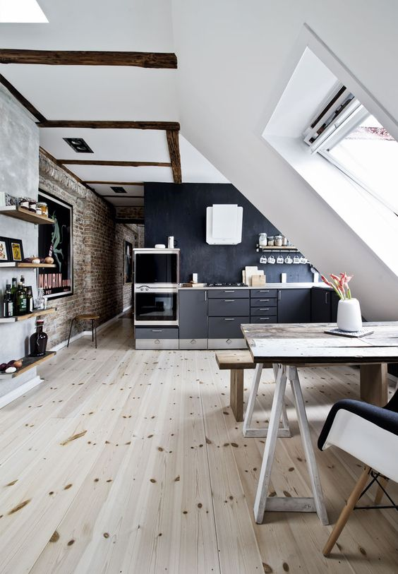 kitchen, wooden floor, white ceiling, white sloping wall, table, chairs, bench, blac wall kitchen, black cabinet