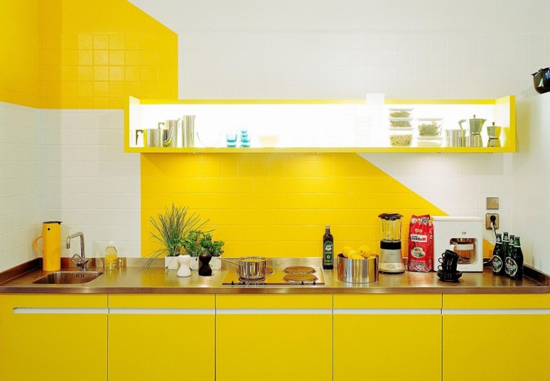 kitchen, yellow bottom cabinet, silver counter top, yellow floating shelves with LED lighting inside, yellow white backsplash wall