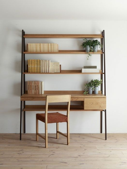 ladder wth wooden shelves, table, and drawer, black metal legs, wooden floor, white wall, wooden chair